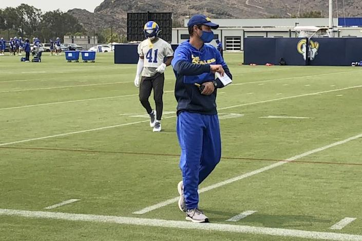 Los Angeles Rams defensive coordinator Brandon Staley watches football practice at the team's training.