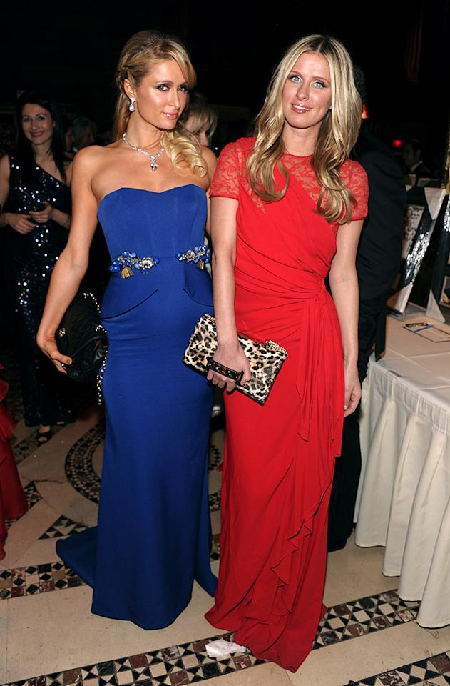 Diamonds may be a girl's best friend, but on Wednesday evening -- at the annual Economics Scholarship Program Gala in NYC -- sisters Paris and Nicky Hilton proved that sapphires and rubies are just as desirable. Looking better than ever, Paris popped her signature pose in a strapless blue gown with a structured bodice and crystal encrusting, while Nicky opted for a fiery, lace-paneled frock and ferocious clutch. Whose jewel-toned outfit do you favor? (12/5/2012)