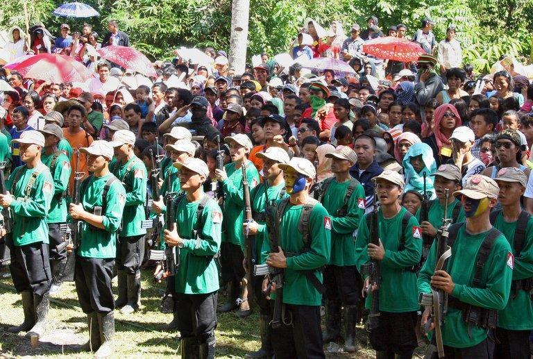 New People's Army (NPA) guerrillas attending a ceremony in the southern island of Mindanao on December 26, 2010