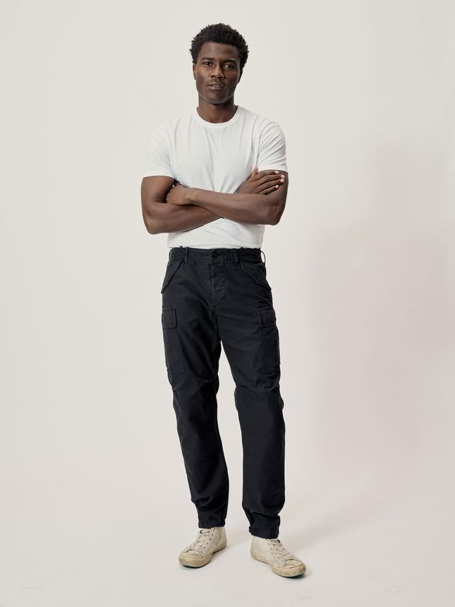 "The minimalist dresser can switch up his look with these utilitarian pants that will pair perfectly with his go-to T-shirt and sneakers. $145, Buck Mason. <a href=""https://www.buckmason.com/products/black-stone-twill-desert-cargo"" rel=""nofollow noopener"" target=""_blank"" data-ylk=""slk:Get it now!"" class=""link rapid-noclick-resp"">Get it now!</a>"