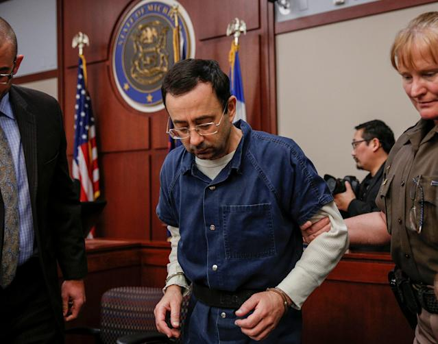 Larry Nassar, a former team USA Gymnastics doctor who pleaded guilty in November 2017 to seven counts of sexual assault, is escorted by a court officer during his sentencing hearing. (Reuters)