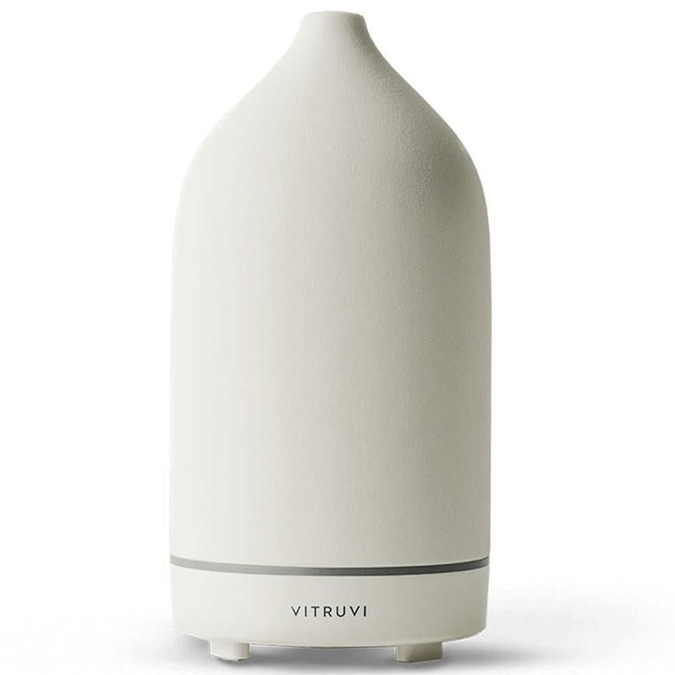 """This sleek <a href=""""https://www.allure.com/gallery/best-essential-oil-diffusers?mbid=synd_yahoo_rss"""" rel=""""nofollow noopener"""" target=""""_blank"""" data-ylk=""""slk:essential oil"""" class=""""link rapid-noclick-resp"""">essential oil</a> Stone Diffuser from Vitruvi features a clean, minimalist design and comes in eight color options to suit any decor scheme. Set the device to a consistent flow for a four-hour run-time, or the intermittent option, which delivers eight hours of misting. The diffuser will automatically shut off when the water runs out."""