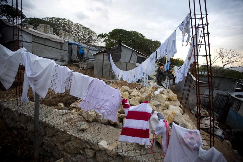 """This Saturday, Jan. 6, 2018 photo shows clothes drying on rebar at the Caradeux refugee camp set up nearly eight years ago for people displaced by the 2010 earthquake, in Port-au-Prince, Haiti. For many, the 8th anniversary of the Jan. 12, 2010 quake was made more painful by President Donald Trump's reported remarks questioning why the U.S. would accept more people from Haiti and """"shithole countries"""" in Africa rather than places like Norway. Trump denied using that language. (AP Photo/Dieu Nalio Chery)"""