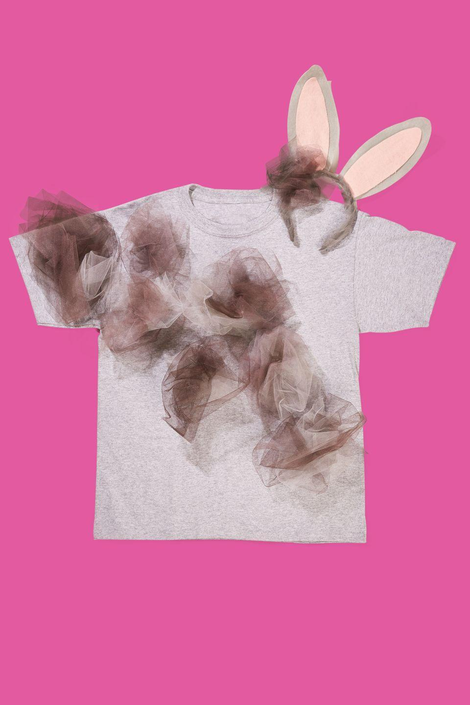 """<p>This clever costume can be whipped up with a healthy supply of brown-and-gray, a gray t-shirt, and some <span class=""""redactor-unlink"""">bunny ears</span>. Bunch up the tulle into tufts, then glue them onto the t-shirt with hot glue. </p><p><strong><a class=""""link rapid-noclick-resp"""" href=""""https://www.amazon.com/Jacobson-Hat-Company-Headband-Fluffy/dp/B00ODBIEJG/?tag=syn-yahoo-20&ascsubtag=%5Bartid%7C10070.g.490%5Bsrc%7Cyahoo-us"""" rel=""""nofollow noopener"""" target=""""_blank"""" data-ylk=""""slk:SHOP BUNNY EARS"""">SHOP BUNNY EARS</a></strong></p>"""