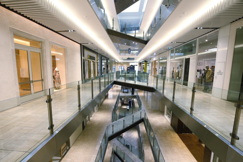 MELBOURNE, AUSTRALIA - AUGUST 12: An empty Emporium shopping centre is seen on August 12, 2020 in Melbourne, Australia. Victoria has recorded 410 new coronavirus cases overnight, along with 21 COVID-19 deaths, the highest daily death toll since the pandemic began in Australia. Metropolitan Melbourne is under stage 4 lockdown restrictions, with people only allowed to leave home to give or receive care, shopping for food and essential items, daily exercise and work while an overnight curfew from 8pm to 5am is also in place. The majority of retail businesses are also closed. Other Victorian regions are in stage 3 lockdown. The restrictions, which came into effect from 2 August, have been introduced by the Victorian government as health authorities work to reduce community COVID-19 transmissions across the state. (Photo by Darrian Traynor/Getty Images)