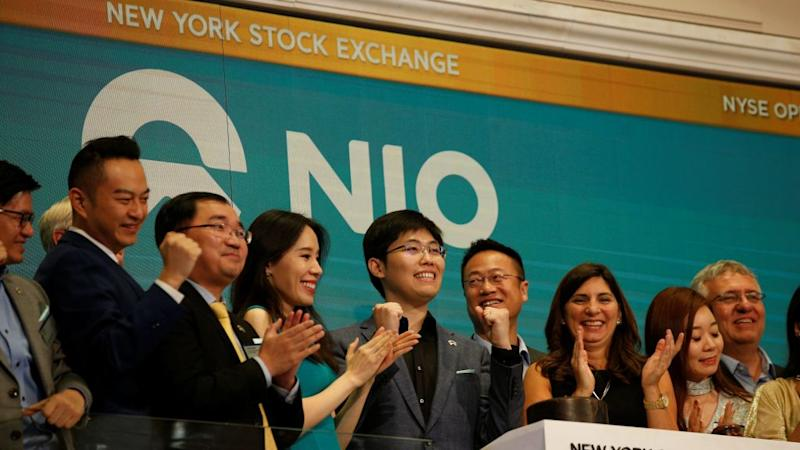 Chinese electric vehicle start-up Nio Inc's first employee Tianshu LI, and company's leadership team celebrate at the New York Stock Exchange (NYSE) Opening Bell to commemorate the company's initial public offering (IPO) at the NYSE in New York, U.S., September 12, 2018.