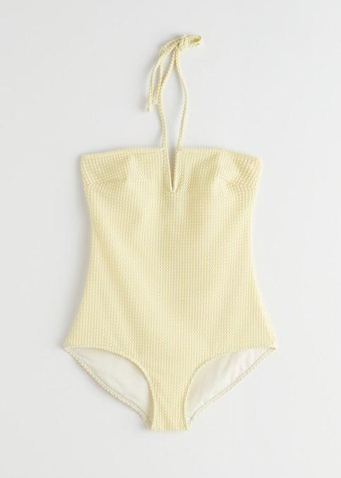 <p>Sometimes, it's all in the details. A subtle print, a straight neckline, and a delicate V-cutout make this <span>&amp; Other Stories yellow check suit</span> ($69) one of our favorites.</p>