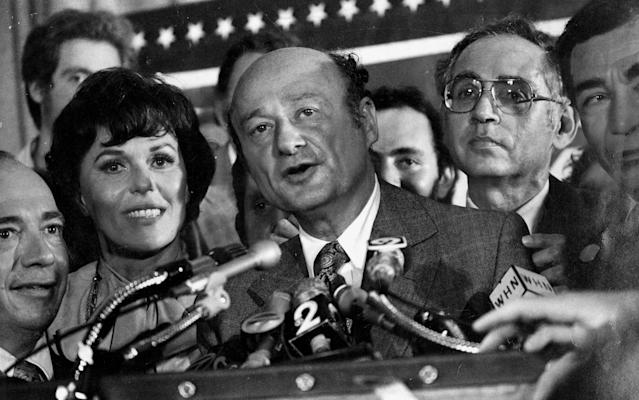 Bess Myerson at his side. Ed Koch makes victory statement. At extreme right is Herman Badillo, Sept. 20, 1977. (Photo by Charles Ruppmann/NY Daily News Archive via Getty Images)
