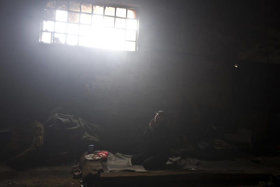 <p>Unaccompanied minor Caesar, 16, a migrant from Pakistan's tribal area of Bajaur, prays in an abandoned warehouse where he and other migrants took refuge in Belgrade, Serbia, Feb. 3, 2017. (Photo: Muhammed Muheisen/AP) </p>