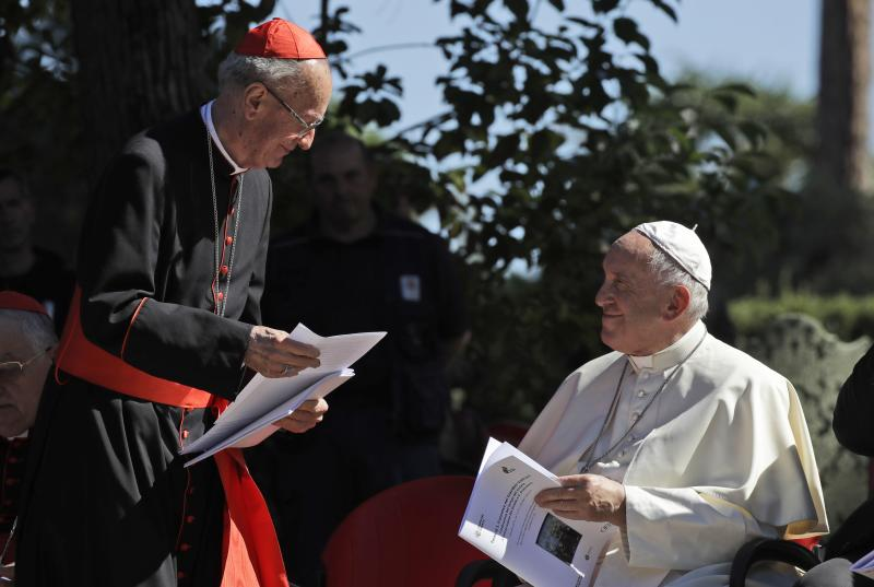 Cardinal Claudio Hummes, General Rapporteur for the Synod of Bishops for the Pan-Amazon region, left, shares a word with Pope Francis on the occasion of the feast of St. Francis of Assisi, the patron saint of ecology, in the Vatican gardens, Friday, Oct. 4, 2019. The ceremony takes place two days before a Synod of bishops on the Pan-Amazon region opens at the Vatican to address the ecological, social and spiritual needs of indigenous peoples in the Amazon. (AP Photo/Alessandra Tarantino)