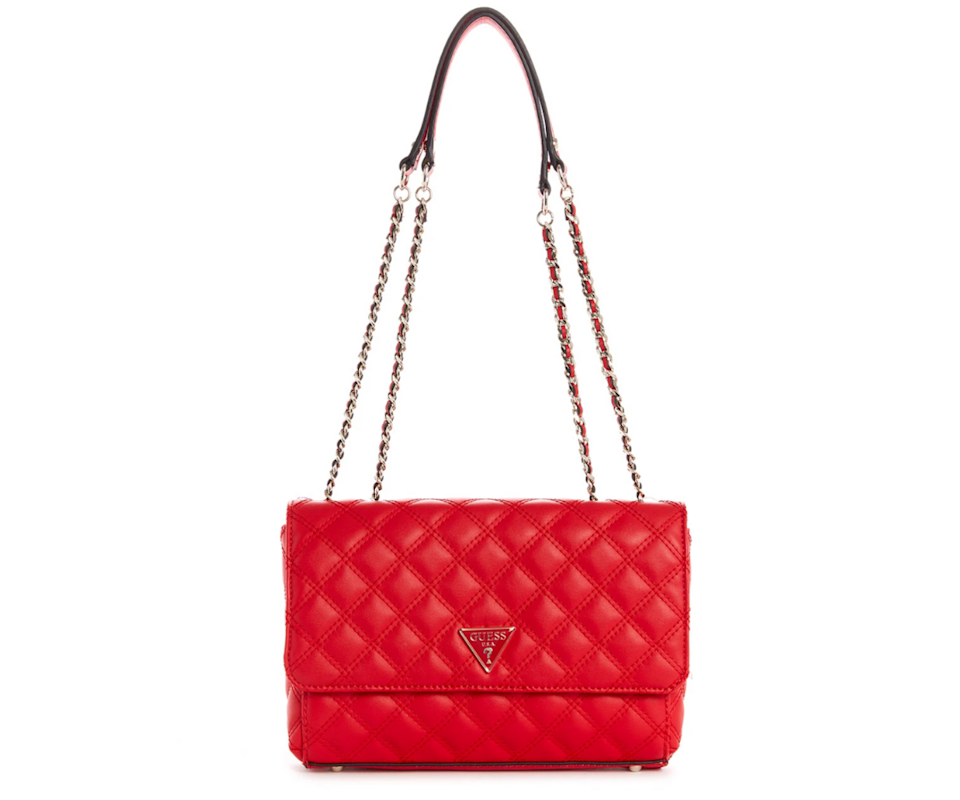This ruby red bag is a showstopper and an added pop of colour for any outfit. Photo: Guess