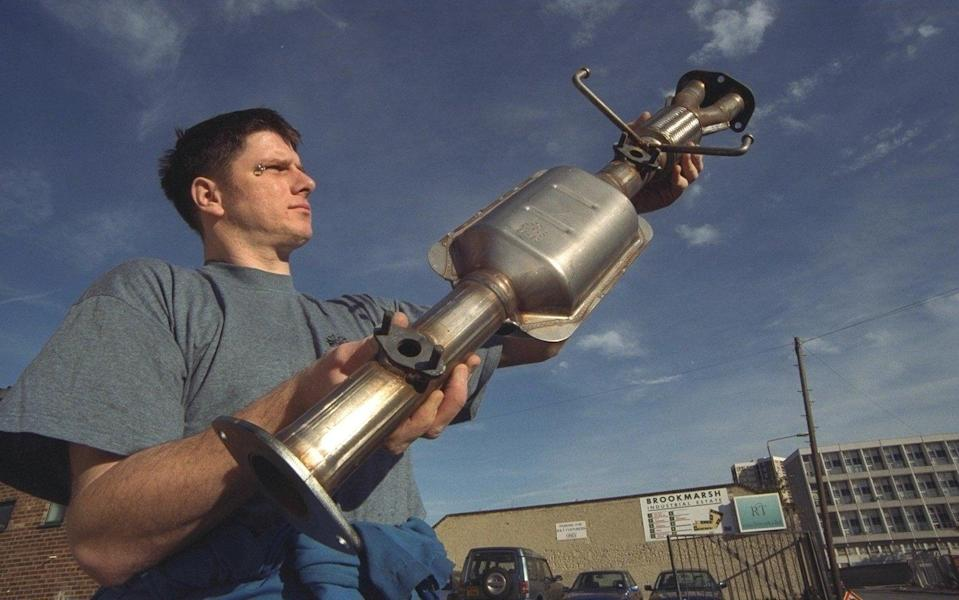 Paul Osborne pictured with a Catalytic Converter at Power Steering Services Greenwich - Roger Taylor