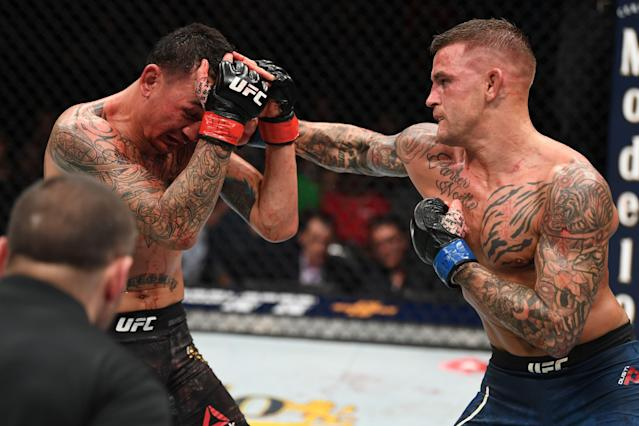 Dustin Poirier punches Max Holloway in their interim lightweight championship bout during the UFC 236 event at State Farm Arena on April 13, 2019 in Atlanta. (Getty Images)