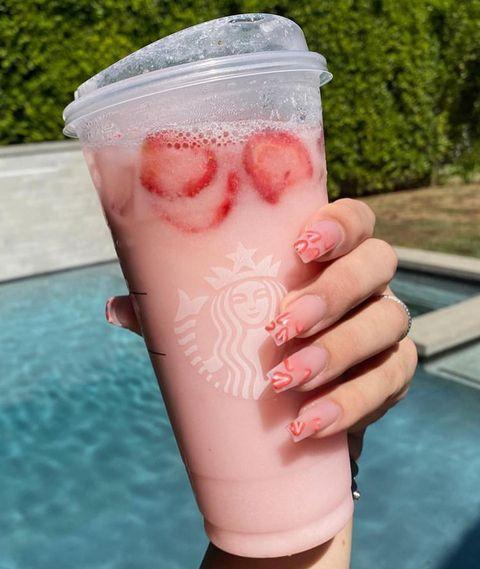 "<p>At this point the words ""pink drink"" are basically synonymous with beauty vlogger <a href=""https://www.seventeen.com/james-charles/"" rel=""nofollow noopener"" target=""_blank"" data-ylk=""slk:James Charles"" class=""link rapid-noclick-resp"">James Charles</a>. He drinks the viral Starbucks beverage every single morning and now even has nails to match. This is a level of dedication that must be respected. </p><p><a href=""https://www.instagram.com/p/B275EcMnuL2/"" rel=""nofollow noopener"" target=""_blank"" data-ylk=""slk:See the original post on Instagram"" class=""link rapid-noclick-resp"">See the original post on Instagram</a></p>"