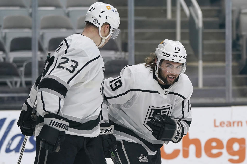 Los Angeles Kings right wing Alex Iafallo (19) celebrates with right wing Dustin Brown (23) after scoring against the San Jose Sharks during the second period of an NHL hockey game in San Jose, Calif., Wednesday, March 24, 2021. (AP Photo/Jeff Chiu)