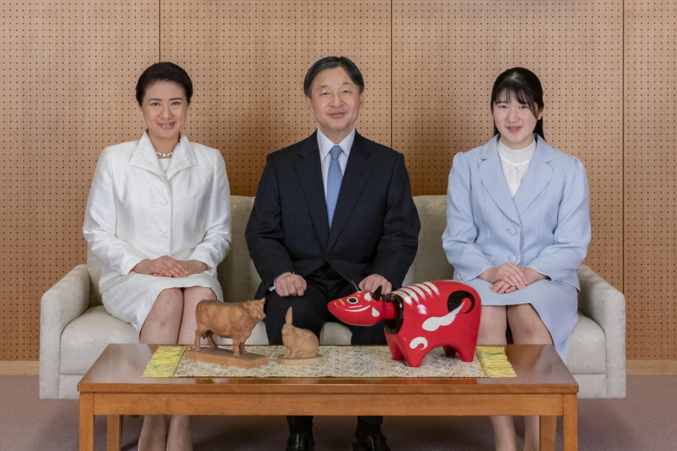 In this photo provided by the Imperial Household Agency of Japan, Japan's Emperor Naruhito, center, Empress Masako, left, and their daughter Princess Aiko pose for a photograph during a family photo session for the New Year at their Akasaka Estate residence in Tokyo, on Dec. 21, 2020. (The Imperial Household Agency of Japan via AP)