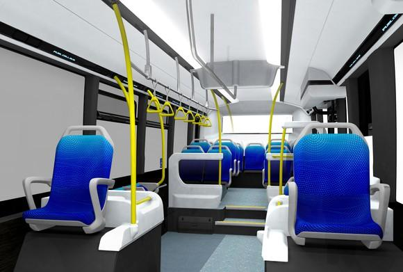 A view of the Sora's interior, showing simple blue seats with yellow grab rails.