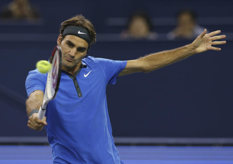 Roger Federer of Switzerland returns a shot to Andy Murray of Britain during the men's singles semifinal match at the Shanghai Masters tennis tournament at Qizhong Forest Sports City Tennis Center in Shanghai, China, Saturday Oct. 13, 2012. (AP Photo/Kin Cheung)