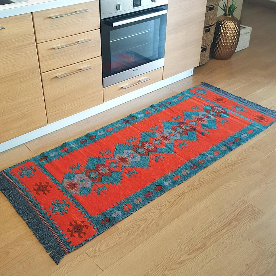 """<h3>Reversible Cotton Area Rug</h3><br>Warm-up your floors with a top-rated, southwestern-style floor covering that looks like you snagged it from last Saturday's flea market. <br><br><strong>Secret Sea Collection</strong> Reversible Cotton Rug Runner, 2.6' x 6' ft, $, available at <a href=""""https://amzn.to/3uCYaIK"""" rel=""""nofollow noopener"""" target=""""_blank"""" data-ylk=""""slk:Amazon"""" class=""""link rapid-noclick-resp"""">Amazon</a>"""