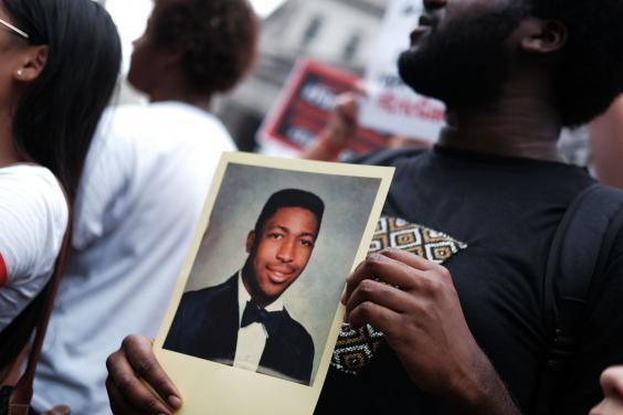 Protesters mark the five year anniversary of the death of Eric Garner, who repeated the phrase