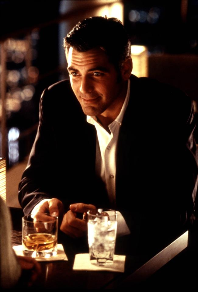 """<a href=""""http://movies.yahoo.com/movie/1800023863/info"""">Out of Sight</a> (1998): Trading snappy banter with a tough-but-feminine Jennifer Lopez, Clooney was sexy as hell as a career bank robber in Steven Soderbergh's funny and surprising film. The scene in which the two flirt at a hotel bar, with its warm lighting and flattering close-ups, is probably the movie's best-known and it crackles with romantic tension. But Clooney is called upon to do much more than smolder. """"Out of Sight"""" ranges from buddy comedy to gripping suspense to sultry noir, and Clooney has the versatility to keep up with all those varying genres. He's probably a bad guy and he's most certainly unreliable, but he's also irresistible. Clooney makes that contrast work."""