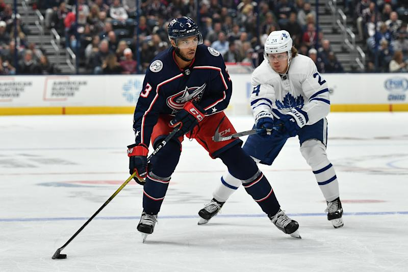 COLUMBUS, OH - OCTOBER 4: Seth Jones #3 of the Columbus Blue Jackets shields the puck from Kasperi Kapanen #24 of the Toronto Maple Leafs during the third period in a game on October 4, 2019 at Nationwide Arena in Columbus, Ohio. (Photo by Jamie Sabau/NHLI via Getty Images)
