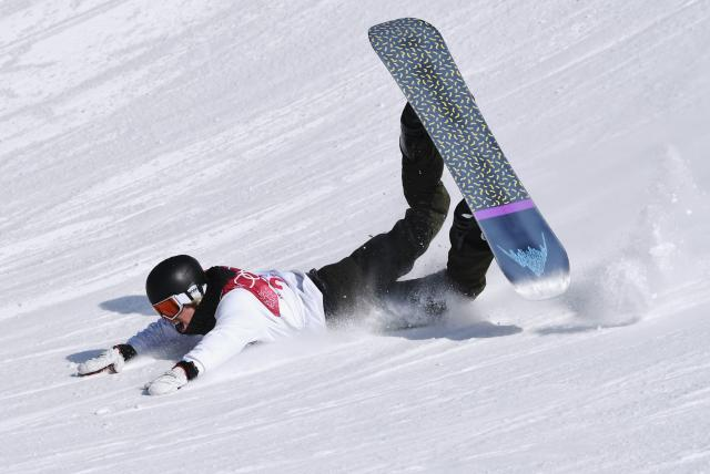 Snowboarding - Pyeongchang 2018 Winter Olympics - Men's Big Air Qualifications - Alpensia Ski Jumping Centre - Pyeongchang, South Korea - February 21, 2018 - Clemens Millauer of Austria falls on the snow as he competes. REUTERS/Toby Melville