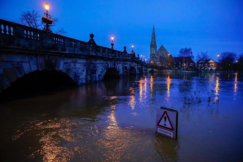 A street sign is part submerged by floodwater after the River Severn burst its banks (Getty Images)