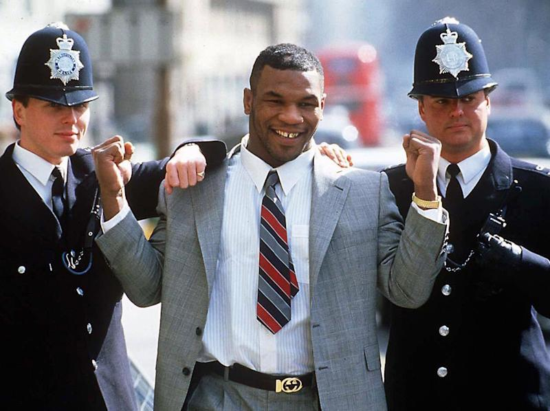 Mike Tyson posing with two police officers, in 1989: Rex Features