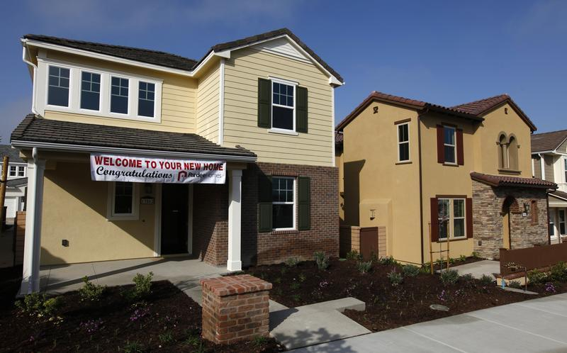 Newly constructed single family homes are shown for sale in San Diego