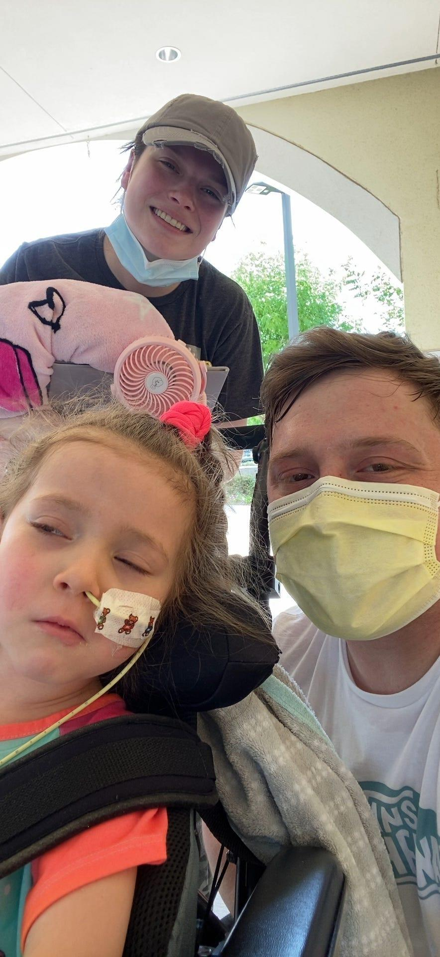 Lylah Baker continues to recover from melioidosis. She is with her parents, Josy and Dustin, on Monday at a rehabilitation hospital in Dallas.