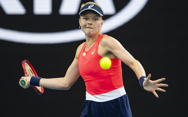 Harriet Dart of Great Britain hits a forehand in her second round match against Simona Halep of Romania on day four of the 2020 Australian Open at Melbourne Park - TPN/Getty Images