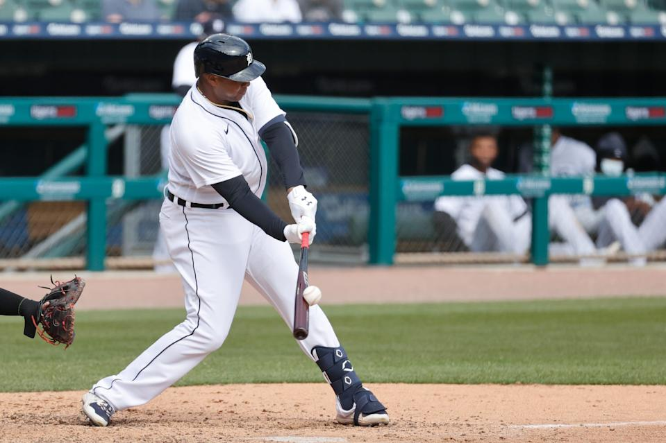 Detroit Tigers first baseman Jonathan Schoop hits a sacrifice fly in the seventh inning against the Cleveland Indians at Comerica Park, Saturday, April 3, 2021.