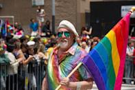 """<p>The late artist Gilbert Baker is credited with creating the first pride flag, which he designed in 1978 for Gay Pride Day in San Francisco, <a href=""""https://www.cnn.com/style/article/pride-rainbow-flag-design-history/index.html"""" rel=""""nofollow noopener"""" target=""""_blank"""" data-ylk=""""slk:per CNN"""" class=""""link rapid-noclick-resp"""">per CNN</a>. </p><p>Baker's iteration of the flag gives a unique meaning to each color, """"hot pink for sex, red for life, orange for healing, yellow for sunlight, green for nature, turquoise for magic, blue for harmony and violet for spirit,"""" he explained. </p><p>""""We needed something to express our joy, our beauty, our power. And the rainbow did that,"""" Baker <a href=""""https://www.cnn.com/2015/06/30/us/rainbow-flagmaker-gilbert-baker/"""" rel=""""nofollow noopener"""" target=""""_blank"""" data-ylk=""""slk:told CNN in 2015"""" class=""""link rapid-noclick-resp"""">told CNN in 2015</a>. """"We're an ancient, wonderful tribe of people. We picked something from nature. We picked something beautiful.""""</p>"""