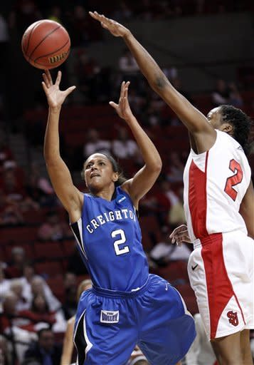 Creighton forward DaNae Moore (2) shoots in front of St. John's forward Amber Thompson (2) in the first half of an NCAA tournament first-round women's college basketball game in Norman, Okla., Sunday, March 18, 2012. (AP Photo/Sue Ogrocki)