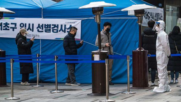 PHOTO: Residents stand in a queue at a temporary COVID-19 testing site in Gangnam Station, Seoul, Dec. 26, 2020. (Simon Shin/SOPA Images/LightRocket via Getty Images, FILE)