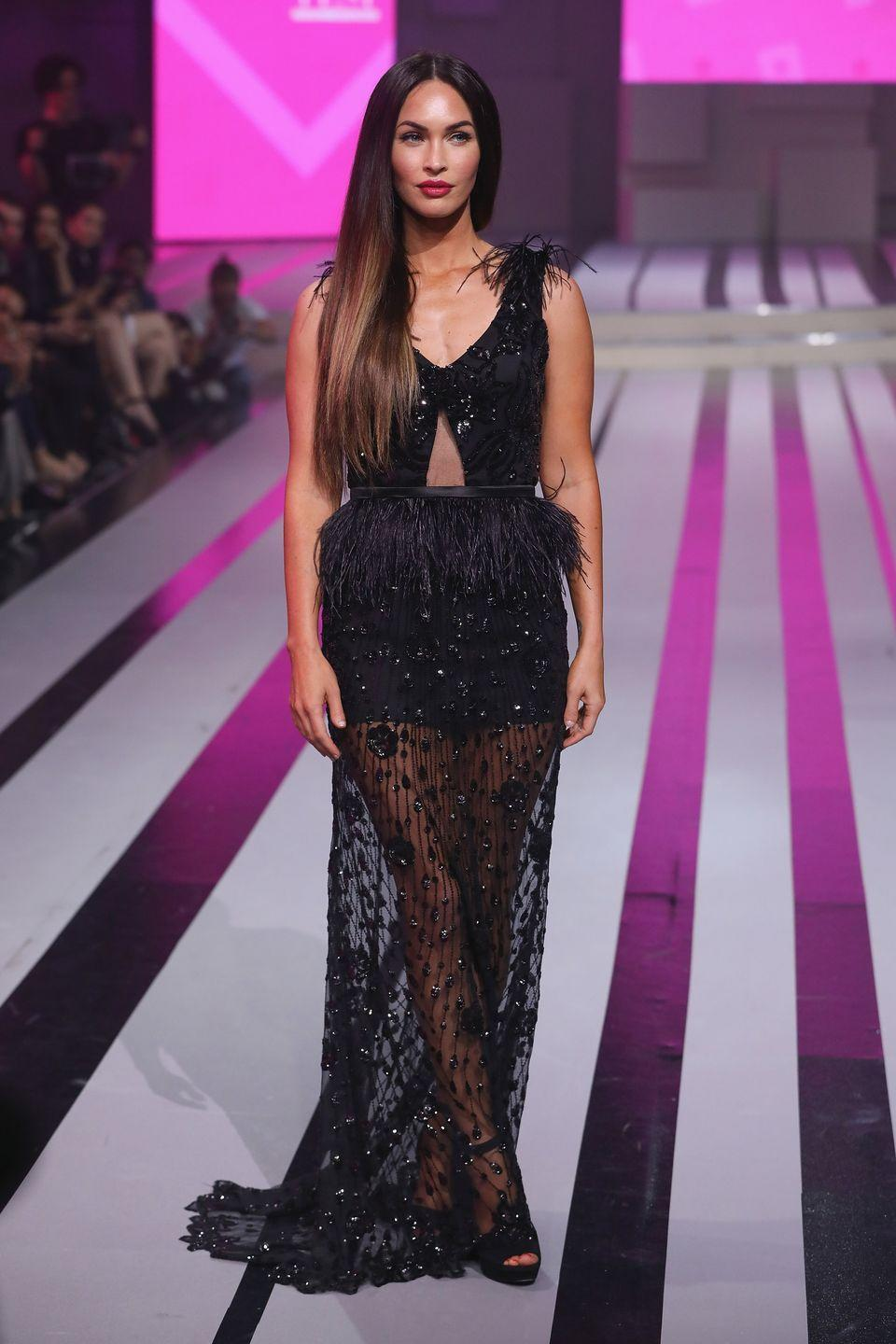 <p>Fox walked the runway during the Liverpool Fashion Fest at Fronton Mexico in a black lace and feathered long dress.</p>