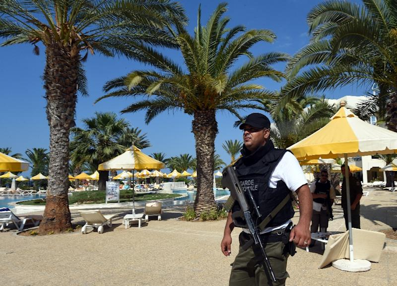 A Tunisian security member stands next to a swimming pool at the resort town of Sousse, a popular tourist destination south of the Tunisian capital, on June 26, 2015, following a shooting attack (AFP Photo/Fethi Belaid)