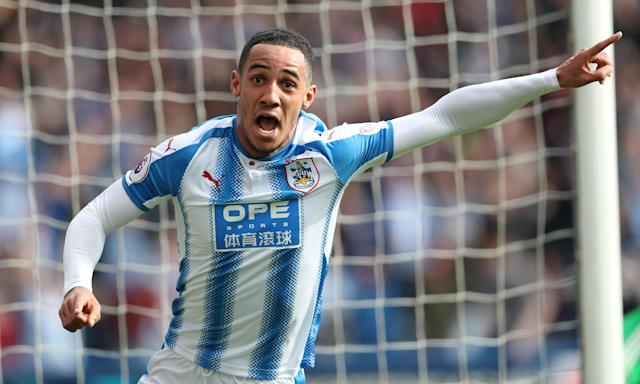 Tom Ince celebrates after his late strike puts Huddersfield into the lead against Watford.