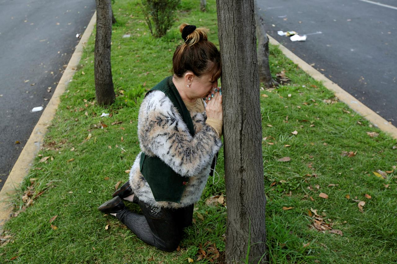 <p>A woman prays after a tremor was felt in Mexico City, Mexico, Sept. 23, 2017. (Photo: Jose Luis Gonzalez/Reuters) </p>