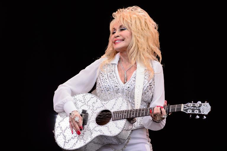 US country music singer Dolly Parton performs on the Pyramid Stage, on the final day of the Glastonbury Festival of Music and Performing Arts on Worthy Farm in Somerset, southwest England, on June 29, 2014 (AFP Photo/Leon Neal)