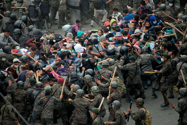PHOTO: Honduran migrants, part of a caravan heading to the United States, clash with Guatemalan security forces in Vado Hondo, Guatemala, Jan. 17, 2021. (Johan Ordonez/AFP via Getty Images)