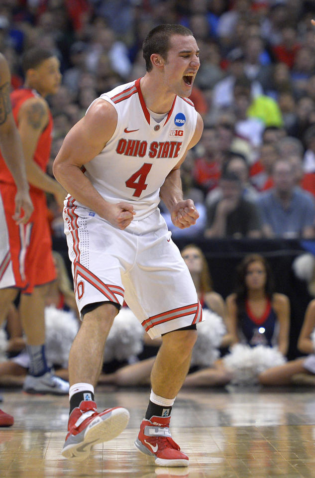 Ohio State's Aaron Craft celebrates a goal against Arizona during the second half of a West Regional semifinal in the NCAA men's college basketball tournament, Thursday, March 28, 2013, in Los Angeles. (AP Photo/Mark J. Terrill)