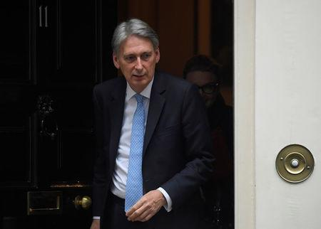 Britain's Finance Secretary Philip Hammond leaves 11 Downing Street, London