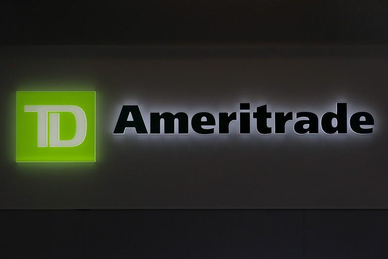 FILE PHOTO: A TD Ameritrade sign glows at the entrance to a branch in the financial district in New York
