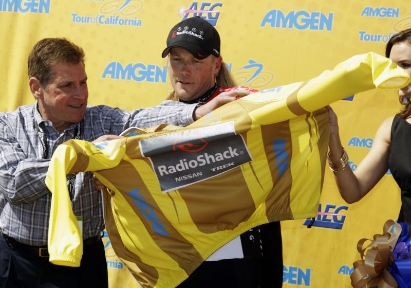 Chris Horner puts on the yellow jersey after winning Wednesday's stage of the Tour of California cycling race in San Jose, Calif., May 18, 2011. (AP Photo/Eric Risberg)