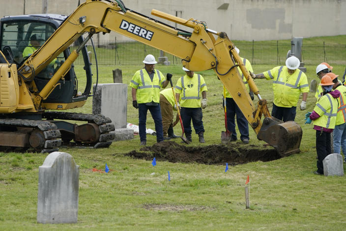 Excavation begins anew at Oaklawn Cemetery in a search for victims of the Tulsa race massacre believed to be buried in a mass grave, Tuesday, June 1, 2021, in Tulsa, Okla. (AP Photo/Sue Ogrocki)