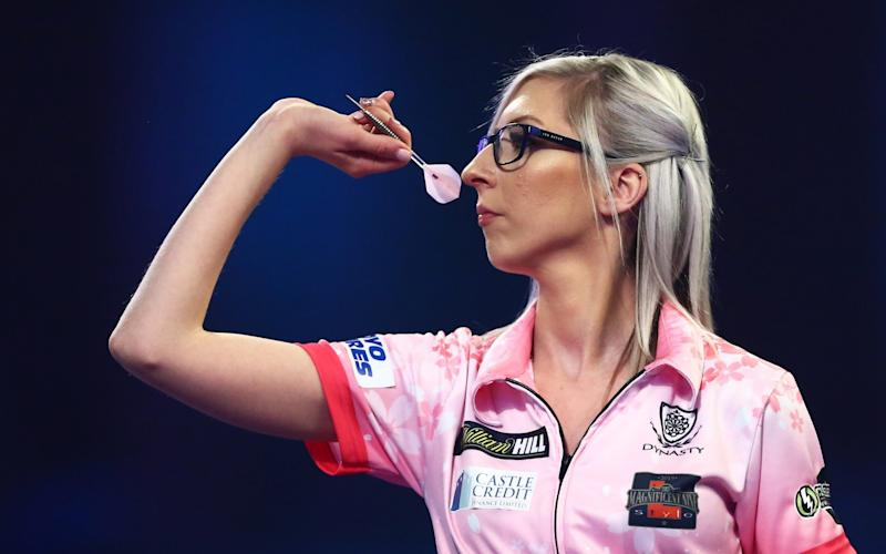 Fallon Sherrock of England throws during her third round match against Chris Dobey of England on Day 12 of the 2020 William Hill World Darts Championship at Alexandra Palace - GETTY IMAGES