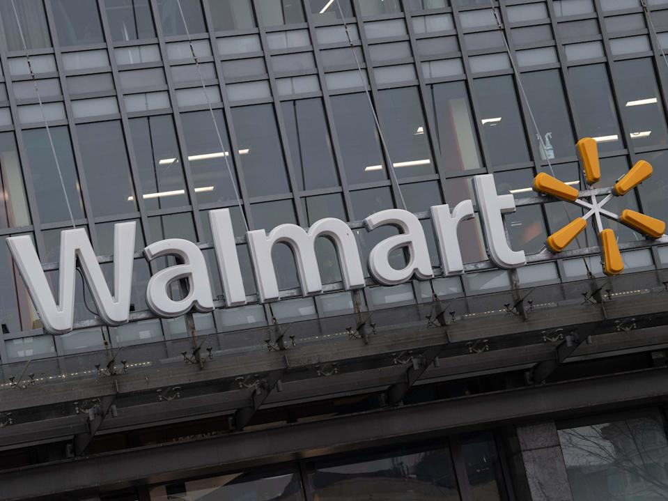 <p>The Walmart logo is seen on a store in Washington, DC, on 1 March 2019</p> ((AFP via Getty Images))