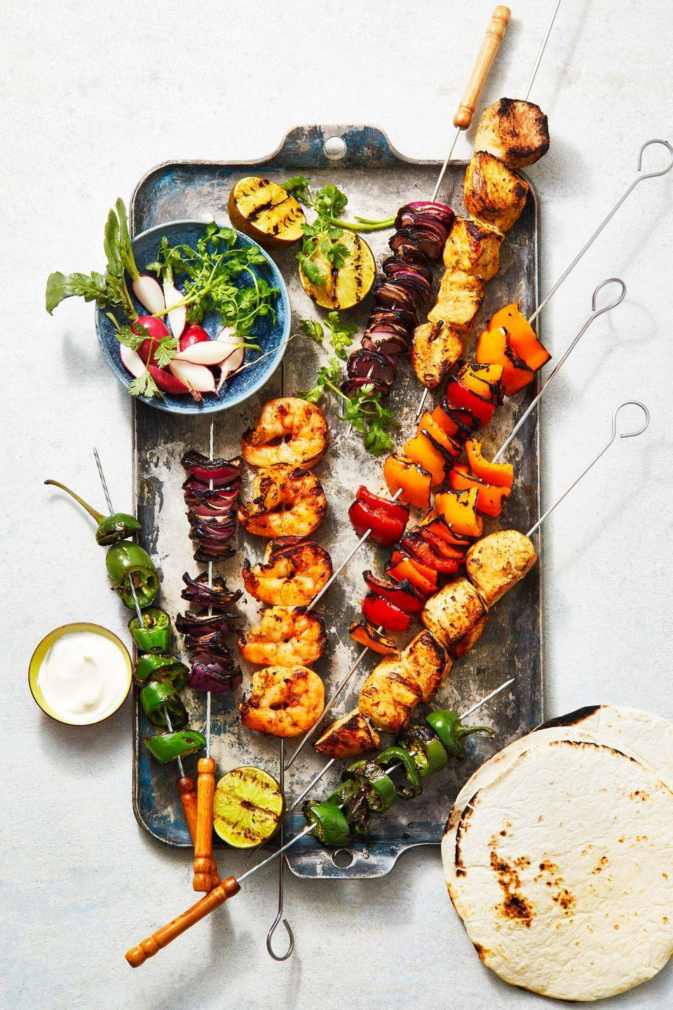 """<p>Loaded with veggies and lean chicken breast, this is a healthy, family-friendly weeknight dinner. </p><p><em><a href=""""https://www.goodhousekeeping.com/food-recipes/a36756280/grilled-chicken-fajitas-recipe/"""" rel=""""nofollow noopener"""" target=""""_blank"""" data-ylk=""""slk:Get the recipe for Grilled Chicken Fajitas »"""" class=""""link rapid-noclick-resp"""">Get the recipe for Grilled Chicken Fajitas »</a></em></p>"""